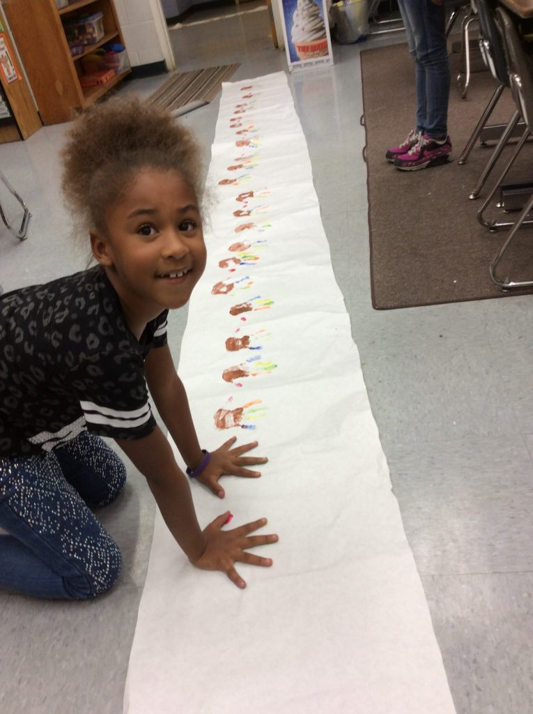 Student placing her hands on a panoramic poster