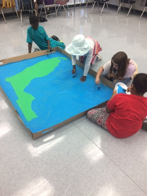 Students working on a large map of Florida