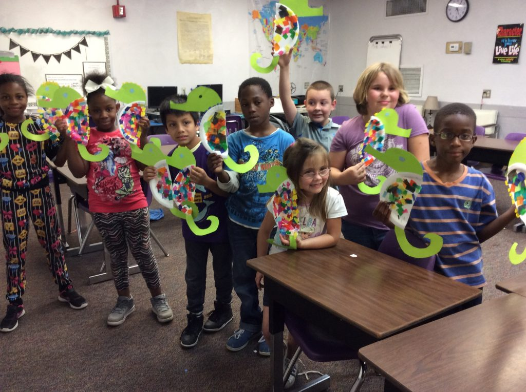 Students with homemade seahorses