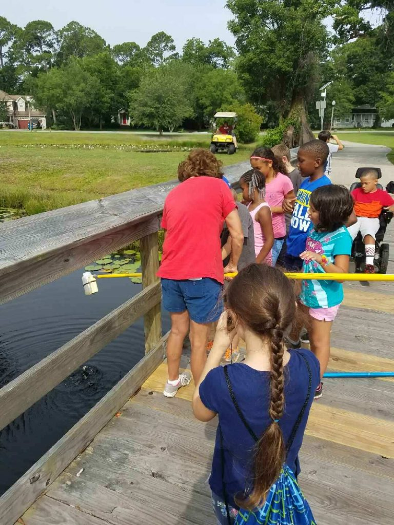 Students fishing outdoors